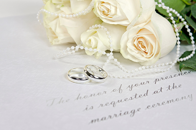 White roses and wedding bands.
